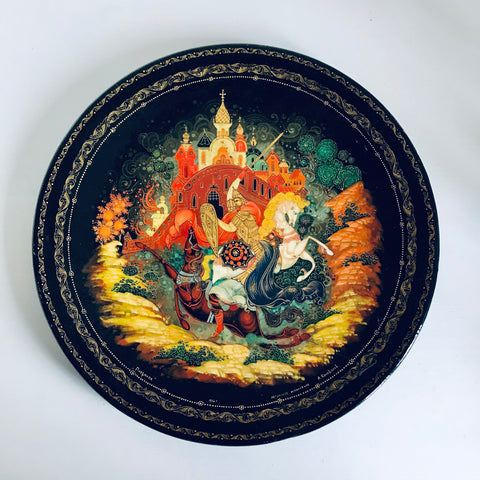 Wooden plate with hand painted decoration