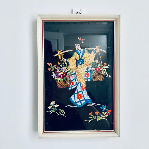 Framed embroidery of a geisha