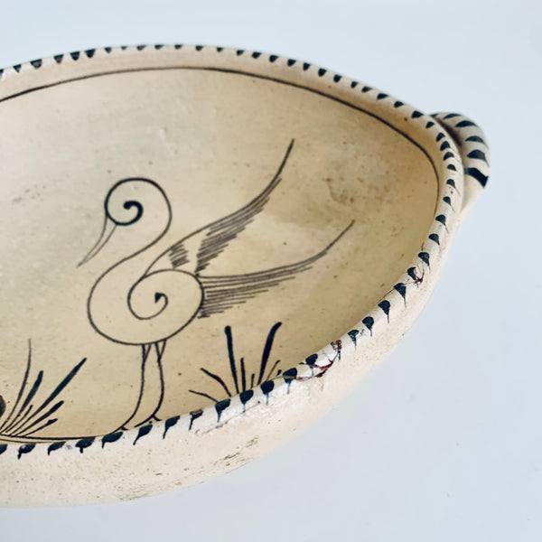 Oval stoneware bowl with bird