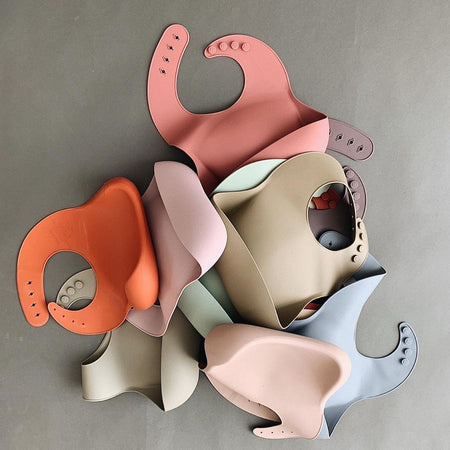 Solid Silicone Bibs by Mushie