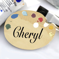 Art Palette Name Badge Wood Background with Paint Dabs on top. Center Text Only