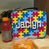 Lunch box with handle. Personalized with colorful Jigsaw Puzzle design and any name