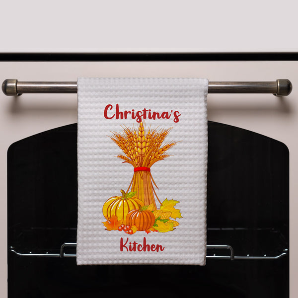 Wheat Stack along with corn, gourds and a few fall leaves and personalized with your custom text on waffle weave kitchen towels
