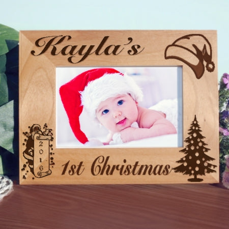 First Christmas Picture Frame for wide photos has santa hat, tree and santa with a scroll showing the year. You can use this frame for any Christmas, first, second, third etc