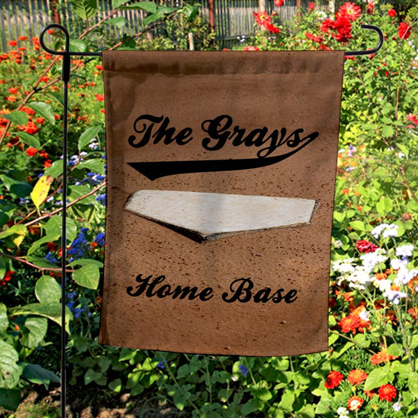 Home plate in the dirt on a custom garden welcome flag with your name and any custom text.
