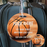 Round Bag Tag Basketball sitting on wood floor personalized with identification name and address