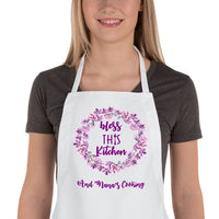 woman wearing bless this kitchen bib apron