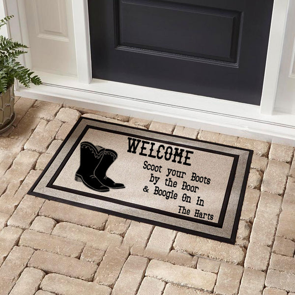 Welcome Doormat pictured in front of a door