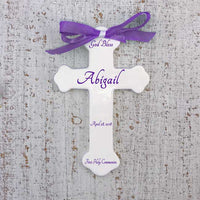 White ceramic cross with purple text