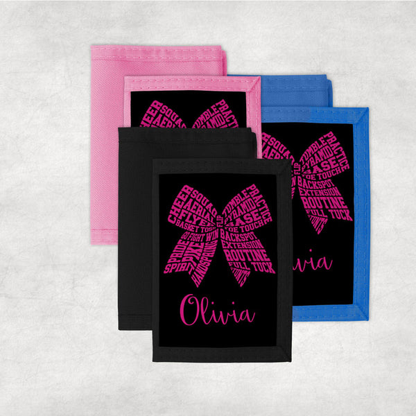 Cheer terms arranged to create a hair bow design on a custom wallet personalized with any name.