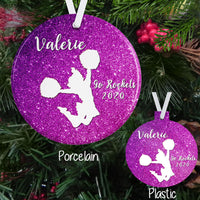 Cheerleader Ornaments Sparkly Printed Background with White Cheerleader Jumping and Your personalized text on a porcelain or plastic ornament