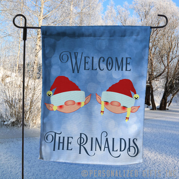 Elf couple yard flag personalized with any name and Christmas greeting.