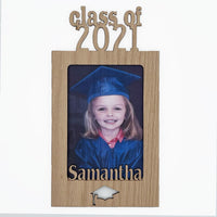 wood cut out name mat has class of 2021 cut out on top, any name and a graduation cap cut out on bottom