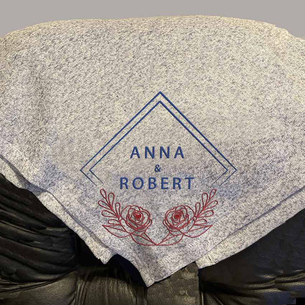 "Any two names in this diamond and rose border on all four corners of a 50"" x 60"" throw blanket"