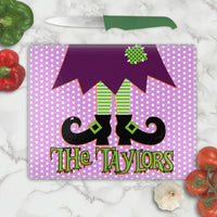 Purple and White Polka Dot Backdrop to Witches feet, legs and skirt in deep purple and fun lime green accents on a tempered glass cutting board with your personalized name or custom text