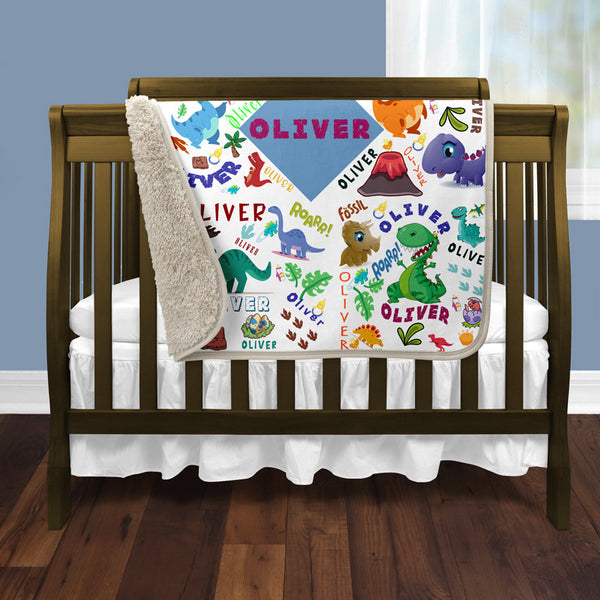 "30"" x 40"" Sherpa Blanket with dinosaurs shown folded over crib"