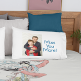 Pillow on bed with photo of father and son that says Miss You More