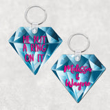 Diamond Shaped Key Ring with Blue Diamond Background 2 sided print one with names the other with He Put A Ring On It in pink text