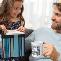 Little Girl with her daddy holding the Dad Word Art mug she just gave him for Father's Day