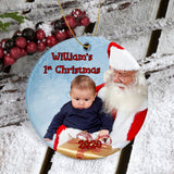 Round Porcelain Photo Ornament with picture of baby with Santa Claus. Custom Text for Name, Message and Year.