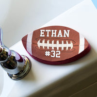 Football Shaped Sponge with Football image and personalized with any name and jersey number or custom text.