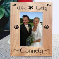 Wood Picture Frame for tall photos with Shamrocks and Swirls personalized with two names on top a last name on bottom and a date