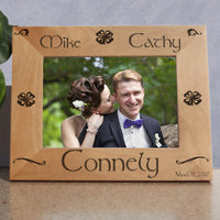 Wood Picture Frame for wide photos with Shamrocks and Swirls personalized with two names on top a last name on bottom and a date
