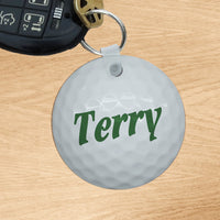 circle shaped key ring with image of golf ball and any name in center
