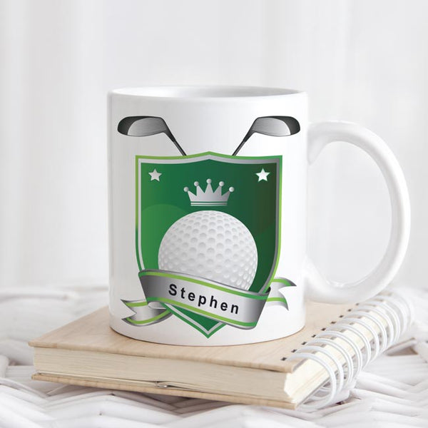 Golf crest with name within the ribbon on the bottom shown on an 11 ounce mug