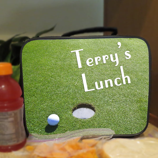Handle Lunch Tote with golf ball on green near hole image also shows snacks