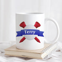 Golf Ball and 2 criss crossed tees with blue ribbon across ball and name in ribbon