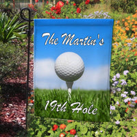Photo of Golf ball on tee in the grass with a blue sky. Any text on top and bottom of flag