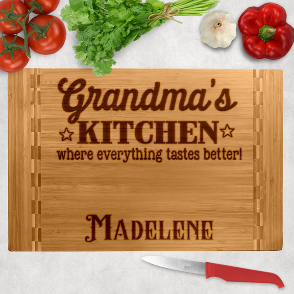 Personalized wood block cutting board with Grandma's (or any title) Kitchen where everything tastes better. Personalized with a name on the bottom