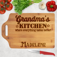 Whose kitchen is where everything tastes better? Wood cutting board with personalized title and name