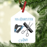 Stylist Tools, comb scissor, blower and iron on a gift tag shaped Christmas Ornament personalized with two lines of text.