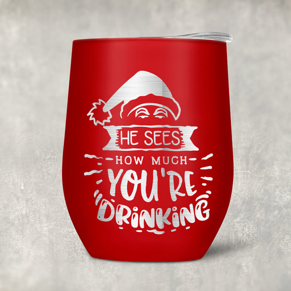 Red Wine Tumbler with lid with Santa Hat that says He Sees How Much You're Drinking. Personalization goes on the second side