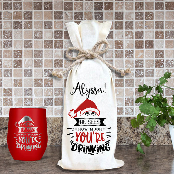 Wine Bottle Bag Gag Gift Says He Sees how much you're drinking with santa claus head and your name