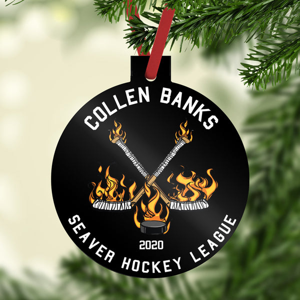 Flaming Hockey Sticks and Puck on a black background with your custom text in white on a reinforced plastic Christmas Ornament
