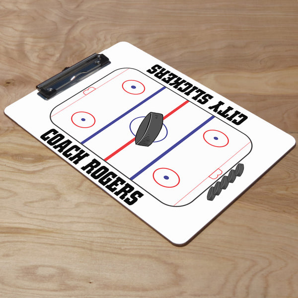 Hockey rink design with pucks and coach's name and team name on a dry erase marker board clip board with flat sports clip.