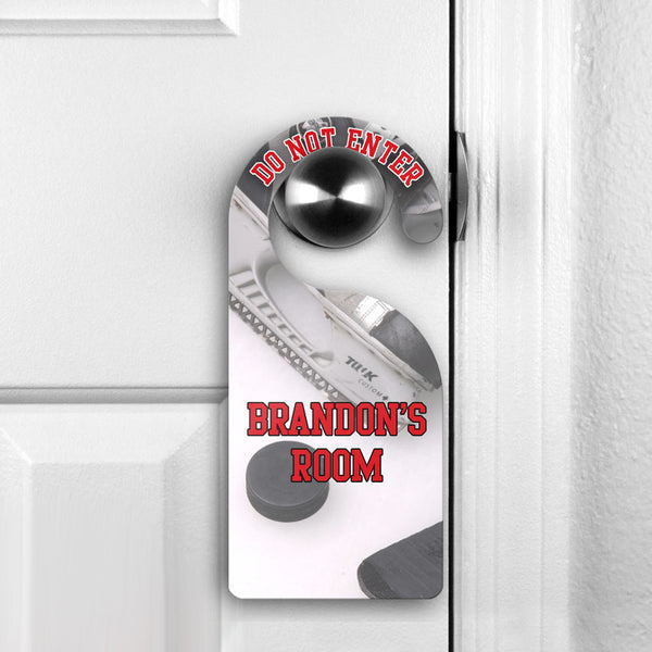 Hockey Theme Do Not Disturb Door Sign pictured hanging on door knob