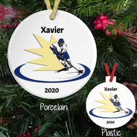 Hockey Player skating with yellow flash behind him on both porcelain and plastic ornament