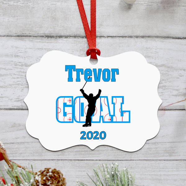Benelux Curved shape Christmas Ornament with Hockey player and rink within the word Goal behind the player with stick in the air after scoring. Personalized with name and year or any custom text