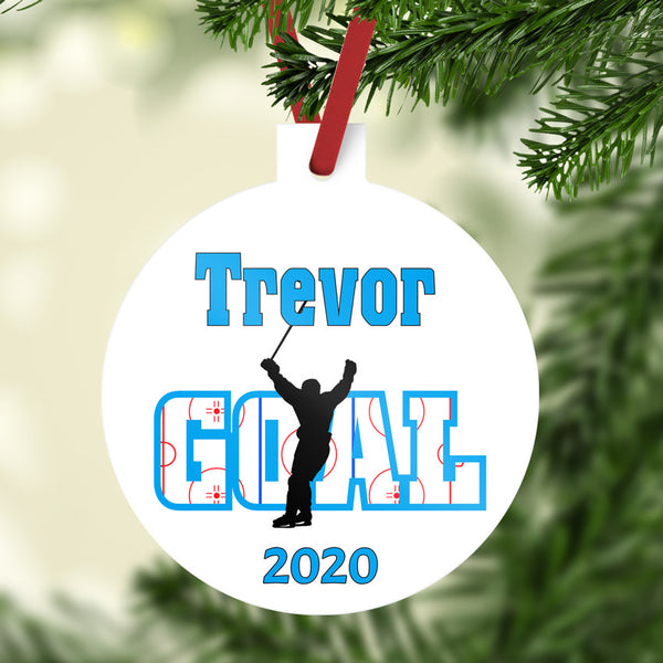 Ball shaped christmas ornament with stem personalized with hockey player skating with stick up in air to indicate he just scored (not high sticked the opposing player lol) Any name on top and year on bottom.