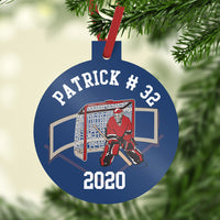 Goalie in front of net on custom hockey ornament. 3 inch plastic ornament with top stem to hold included ribbon. personalized with name, number  and year