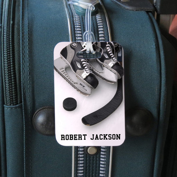 Hockey theme luggage tags with skates puck and stick on ice design and your personalized name.  Side 2 has contact info