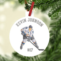 Plastic ornament 3: diameter. Hockey Player with stick and your personalized text.