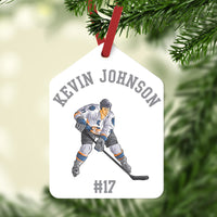 Gift Tag shape Christmas Ornament with Hockey Player in center and arched name on top. Jersey number or year on bottom