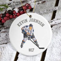Porcelain ornament 2-7/8 diameter. Hockey Player with stick and your personalized text.