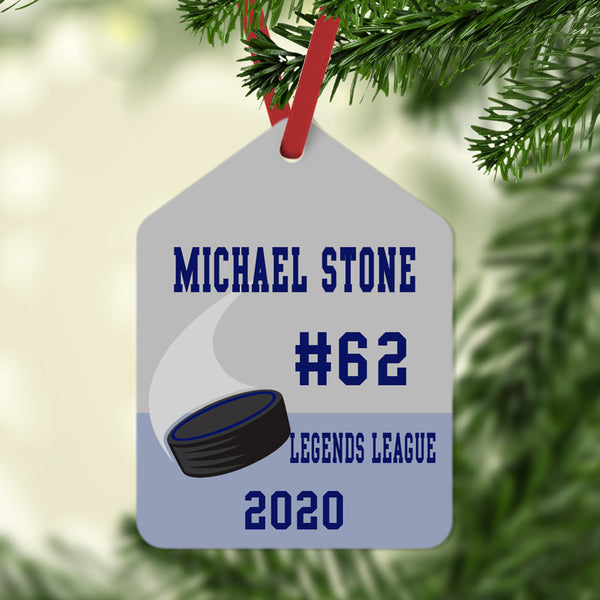 gift tag shaped ornament with hockey puck and four lines of custom text.