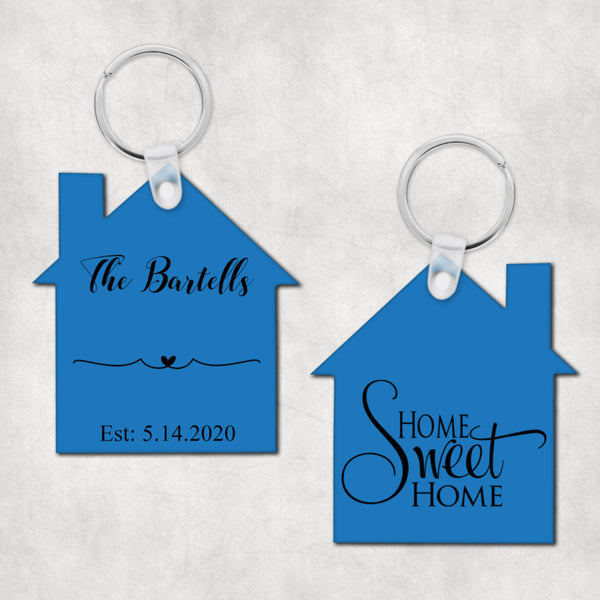 House shaped key ring with Home Sweet Home in fancy font on 1 side and any personalization on the other. Your font choice and color scheme